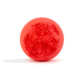Back of red with red toppings bath bomb, with a surprise inside, scented as strawberry on white background without packaging.