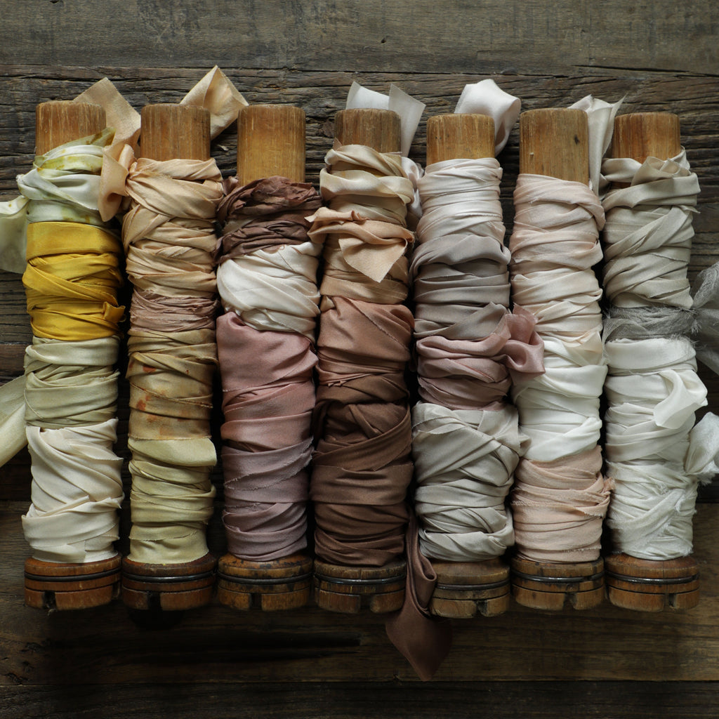 vintage wooden bobbins with silk ribbon