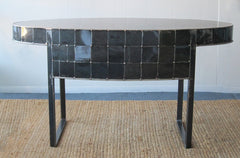 a hand made oval shaped black steel table by Peter Diepenbrock