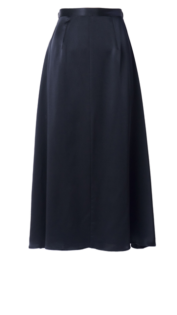 The silk midi skirt by Emerson Fry features a hidden zipper and hook closure with elasticated inserts on the waist. With darting and a center seam on the front, this super soft skirt is an elevated basic that you need for your wardrobe.