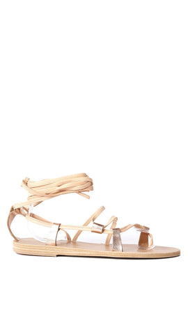 Corine is a nude-hue strappy sandal that features a lace-up ankle detail and metallic loopholes.