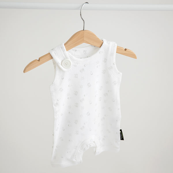 Organic baby romper in white with print in dove grey. Front view with shoulder button feature