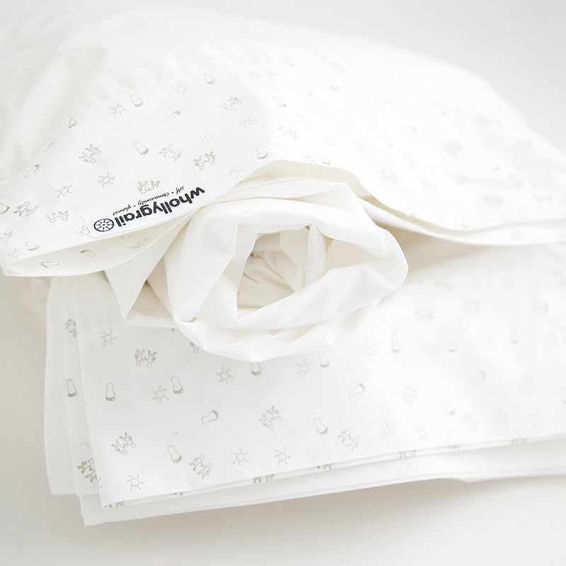 Organic baby cot sheet set in white with dove grey baby print. Fitted, flat sheets and pillowcase.