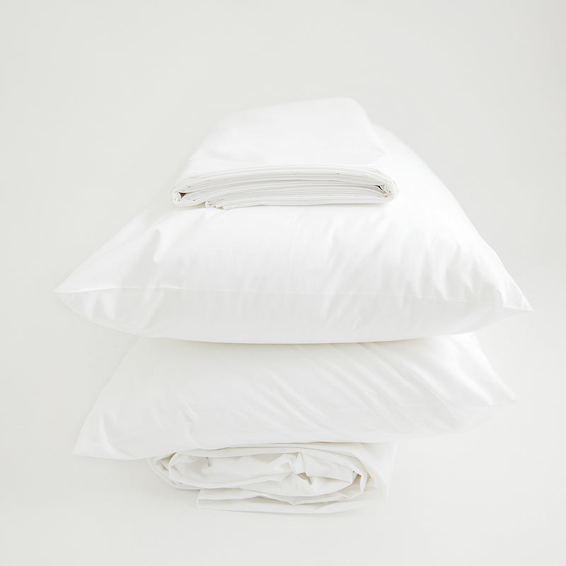 Organic sheet set folded and stacked, white.