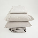 Organic sheets set, folded and stacked, stone