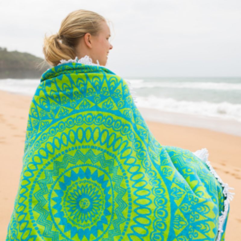 Organic mandala towel wrapped around girl at the beach.