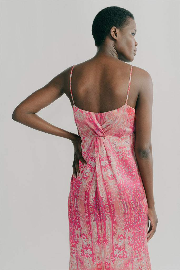 Back view, Sienna features back twists on the empire line
