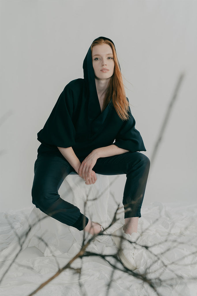 Neneh hoodie in navy satin back crepe silk styled with Boudica track pants in navy silk charmeuse