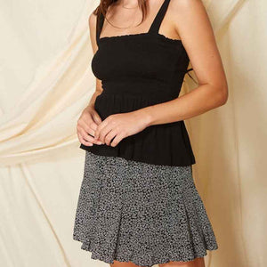Our black flower print skirt is a lined mini skirt with ruffle godet detail.