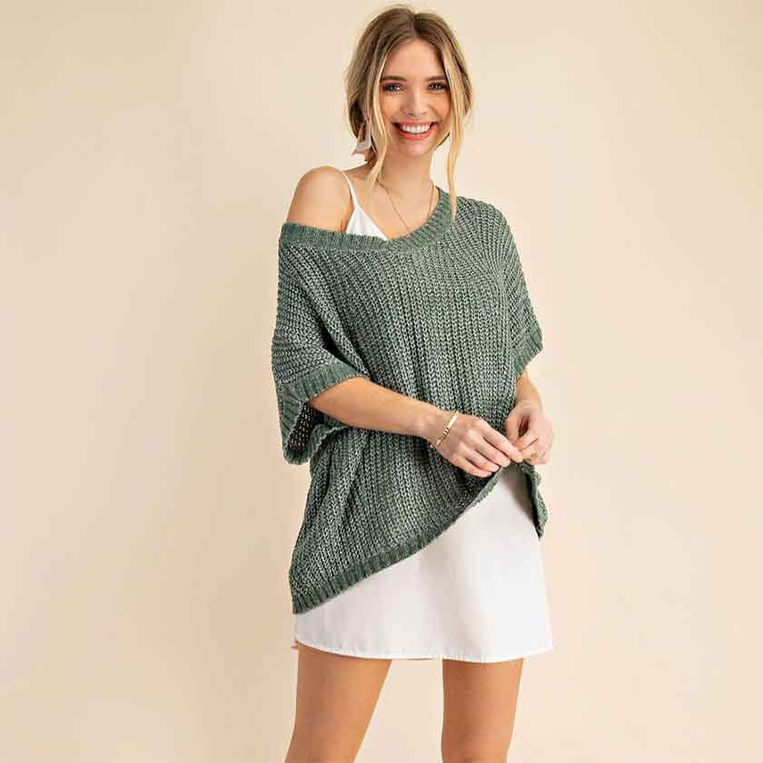 An off the shoulder V-neck sweater in green