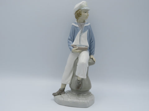 Retired Boy with Yacht Lladro 4810 figure