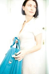 Woman carrying blue bag to airport Design Go