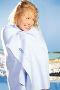 Woman at beach with Design Go Towel