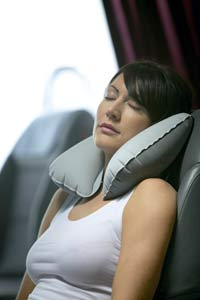 Woman sleeping on airplane with Super Snoozer Pillow Design Go