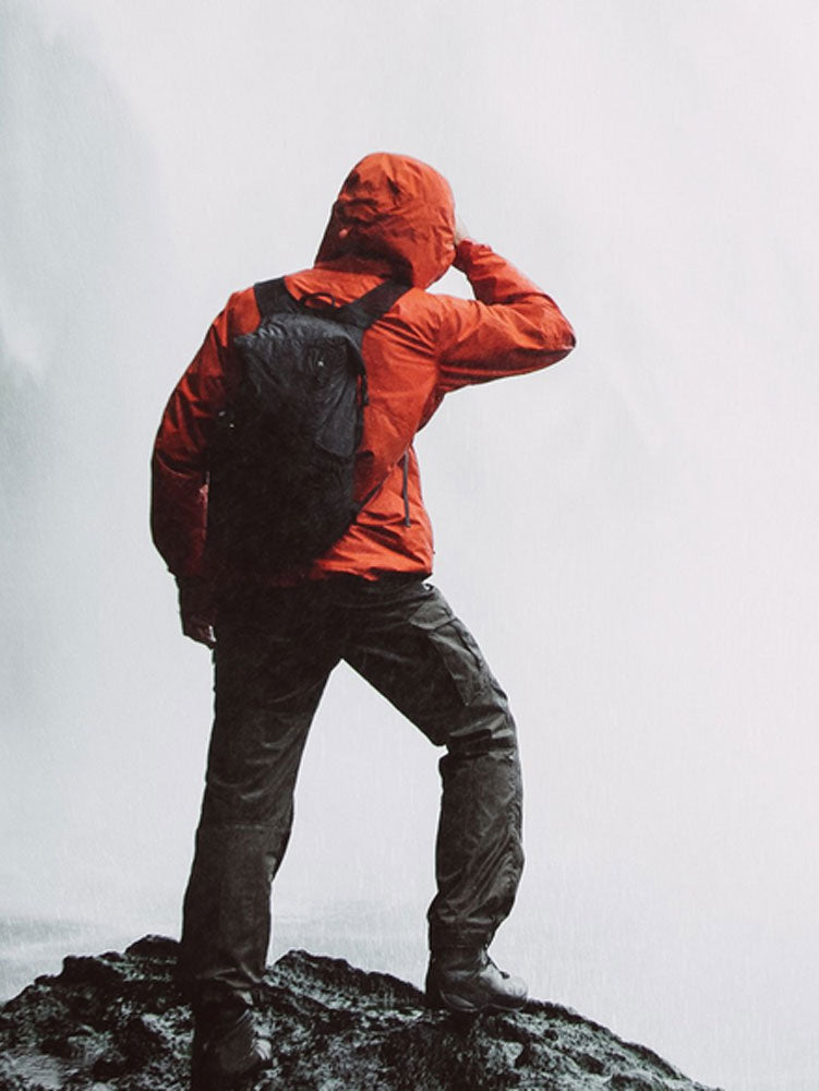 Man Hiking with Matador Travel Backpack in Fog