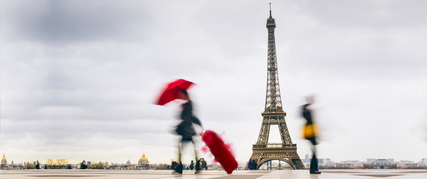 Woman in Paris in Mycra Pac Raincoat and Umbrella