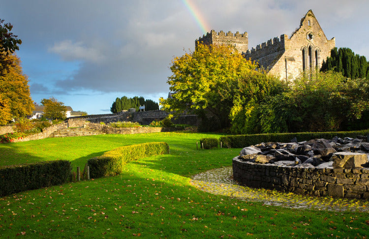 Ireland green landscape castle and rainbow