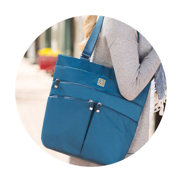 Woman holding Blue Travel handbag