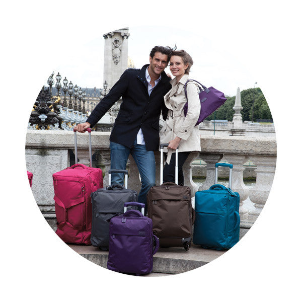 Couple standing with 5 pieces of luggage in paris
