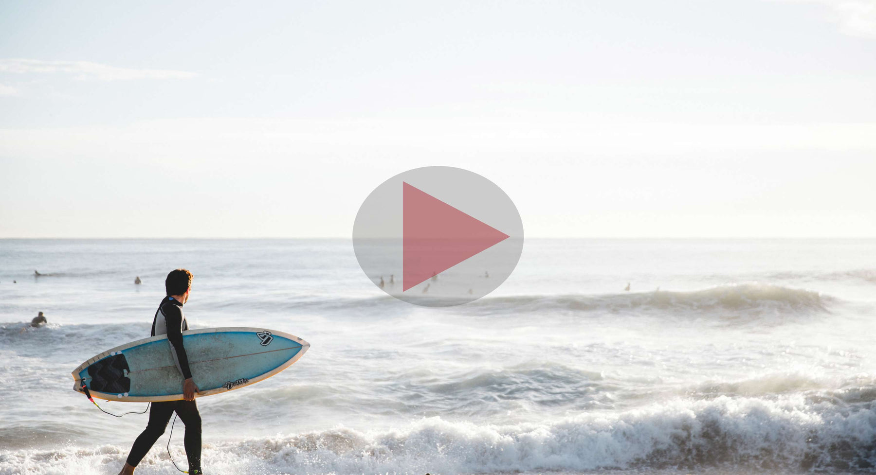 Man with surfboard at beach video