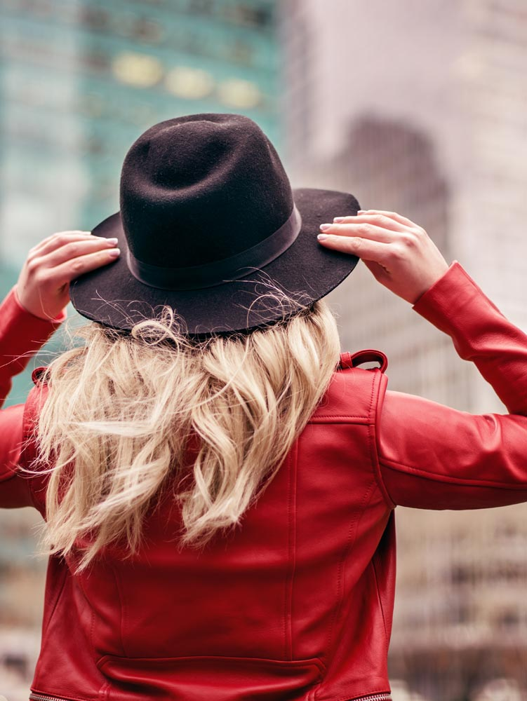 Woman in City Wearing Red Jacket and Cute Hat