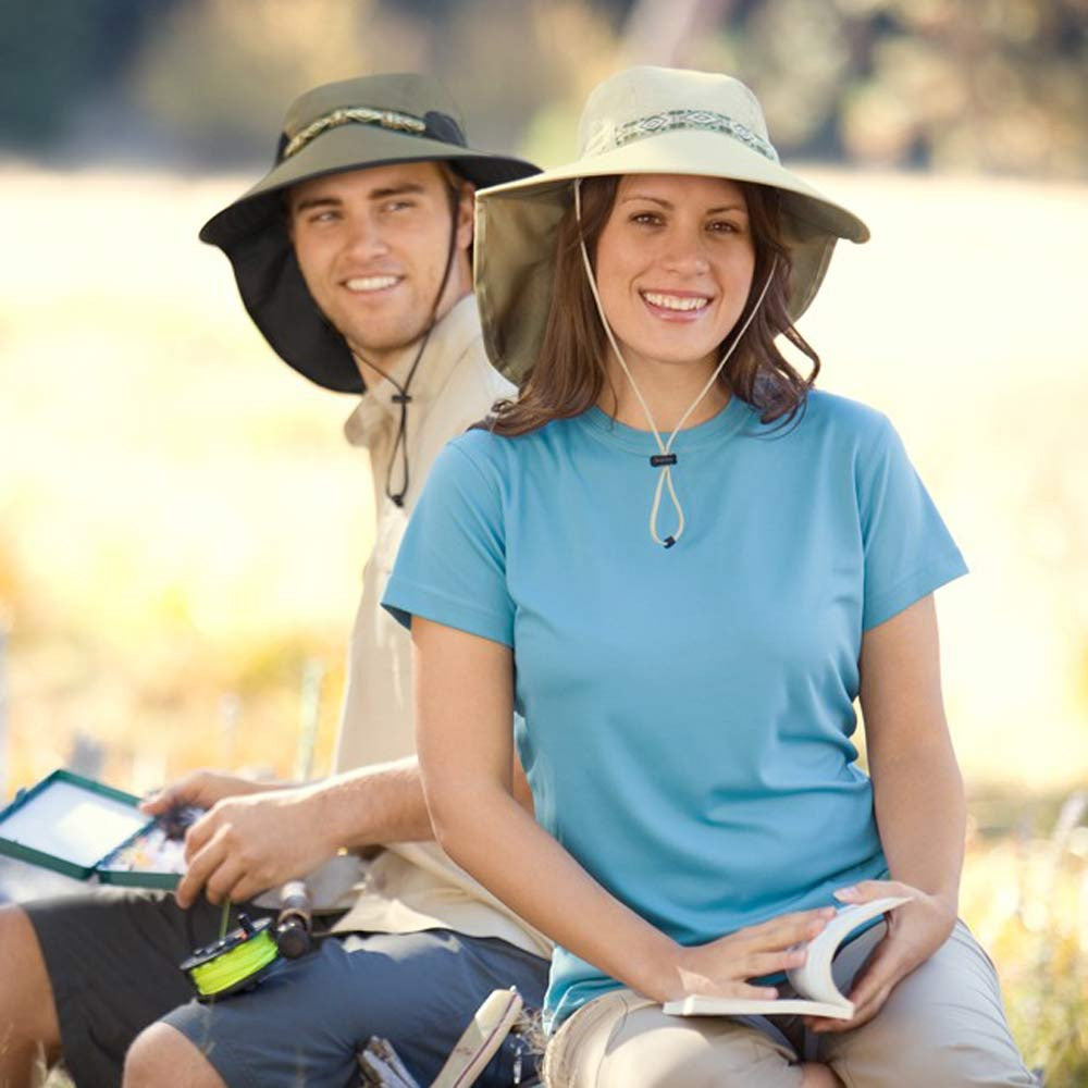 13dcd0dc25b36 ... Couple Sitting In Park Reading While Wearing Adventure Hats in Colors  Sand and Cream ...
