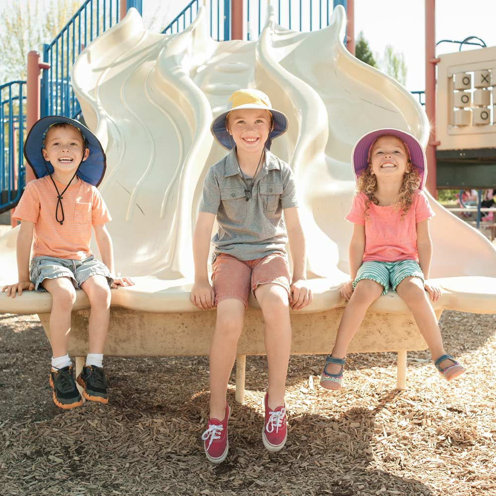ed1f6165f5a ... Sunday Afternoons Kids Play Hat in Colors · Three Kids on Playground  Playing On Slides While Wearing Hats
