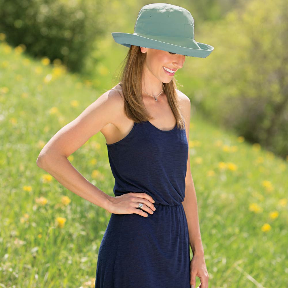bb441009 PaleTurquoise · White · Tan · Woman in Navy Blue Dress Standing In Field  Full of Flowers with Sea Green Casual Traveler