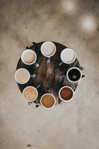 a variety of butter coffee flavors on a serving table