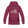 A women's premium hoodie that is warm and cozy, featuring a complementary colored drawstring, kangaroo-style inner pocket, reinforced cuffs and waist, and a fuzzy fleece interior in burgundy.