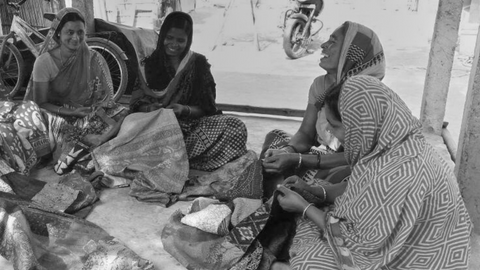 Artisans in West Bengal working in hygienic conditions, laughing together