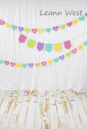 Kate White Curtain with Colored Banners Valentine's Day Backdrop Designed by Leann West