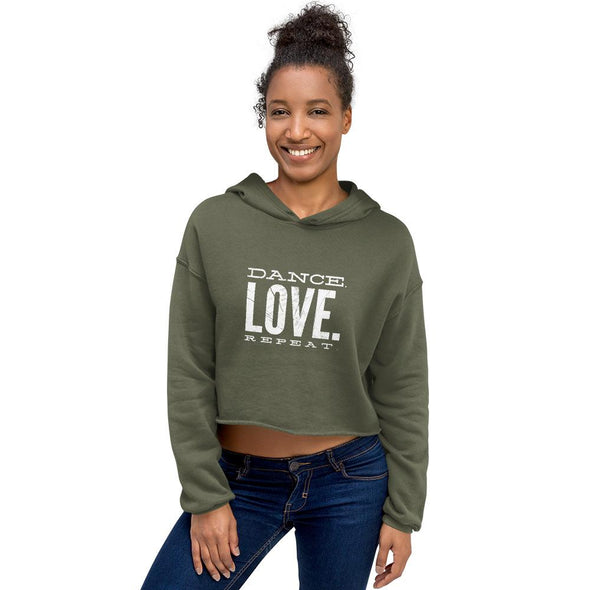 happy black woman wearing a military green dance crop hoodie and jeans