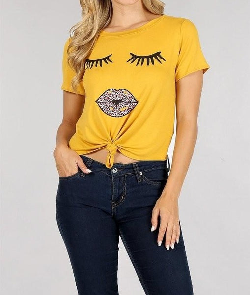 Solid short sleeve cropped tee with a round neckline
