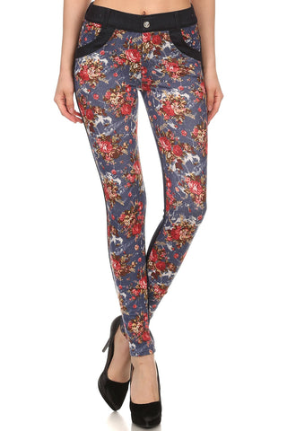 Floral printed slim fit pants with denim contrast and front and back pockets with rhinestone rivet detail at back. Mid rise. Button and zipper closure