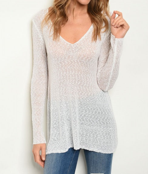 Long sleeve V-neck semi-sheer knit sweater top.