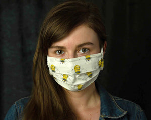 girl wearing white bees filter mask