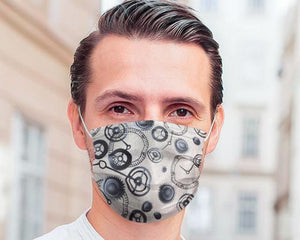 guy wears white filter mask with clocks