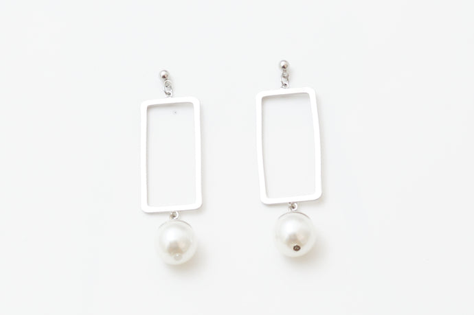 Window pane with Pearl Earrings