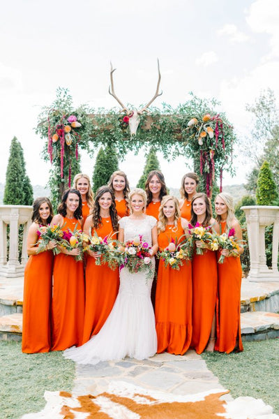 bridesmaids in orange natalie deayala dresses
