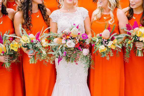 bridesmaids in orange natalie deayala