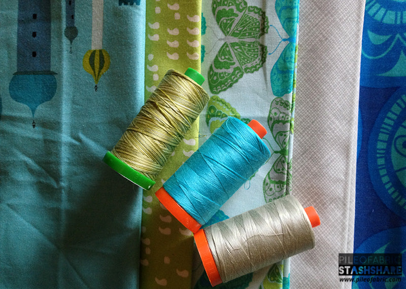 Coordinating threads (left to right) Aurifil 4653, 5005, 5021.