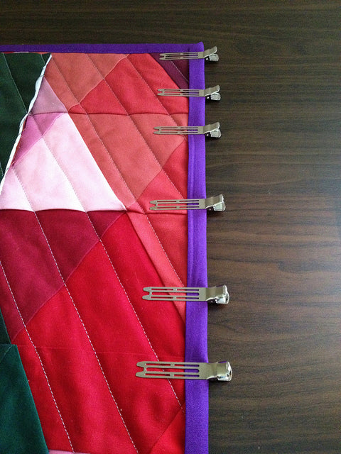 New favorite quilting notion! Conair hair roller clips. Perfect for putting on a binding! So close to finishing my PWP!