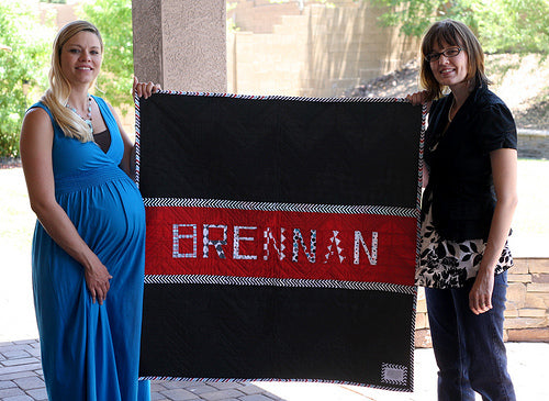 My Beautiful Sister and her quilt for her soon to be son!