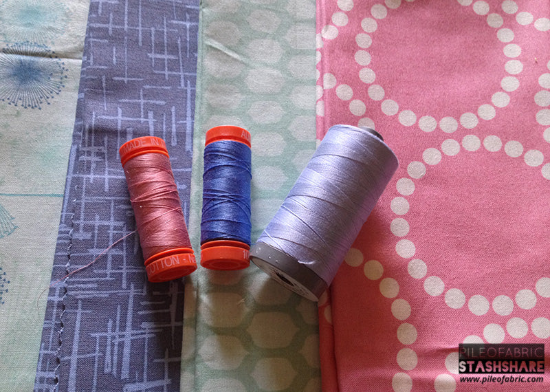 Coordinating threads (left to right) Aurifil 2445, 1128, 2770.