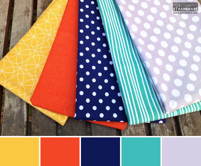 This bundle includes (left to right)  Geo Comma Mustard, Orange Quilters Linen , Indigo Michael Miller Dots, Glimma Korkek Jade, Michael Miller Dots.