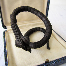 Load image into Gallery viewer, Antique Chinese Carved Victorian Snake Bracelet. Rare Black Nut Wood Articulated Coiled Cobra Bracelet With Silver Eyes.