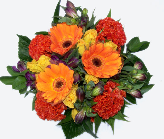 Seasonal red, yellow, orange and purple blooms with greenery