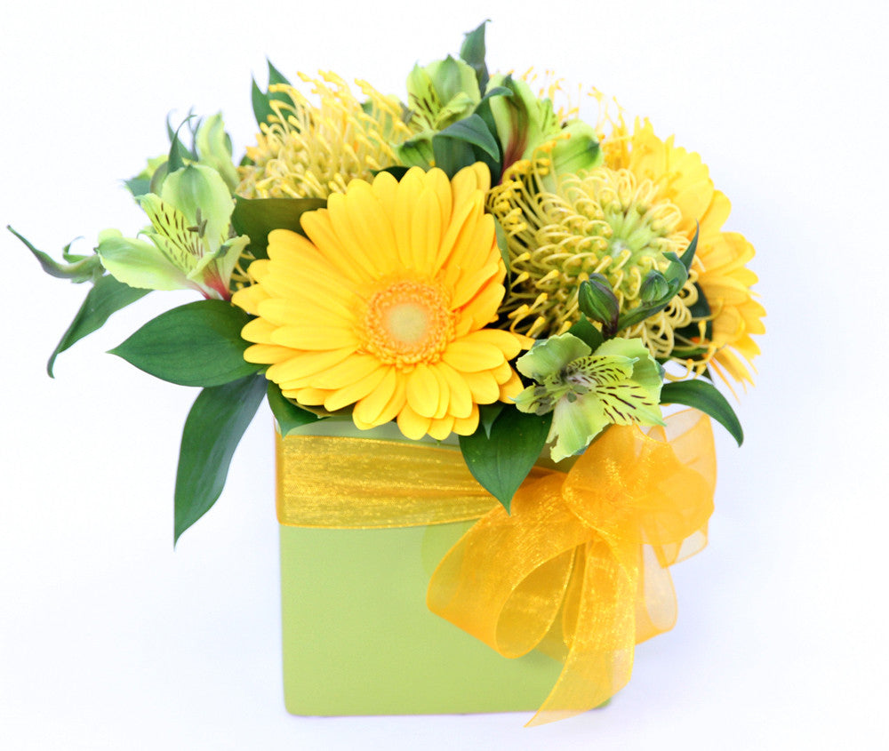 Yellow roses and gerberas.  - One ceramic green pot.