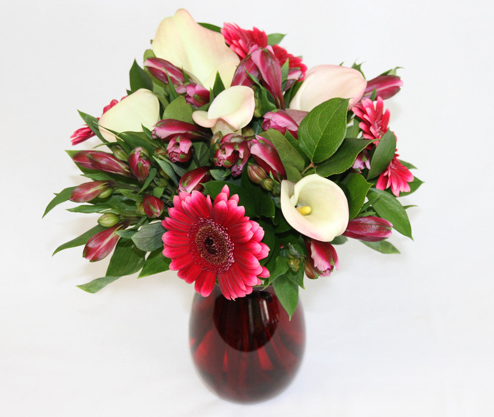 seasonal pink and red flowers placed in a vase